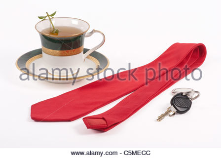Reddish tie, car keys, and a cup of fresh, hot tea. White background. - Stock Image