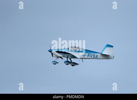 A two seat Van's RV-6A private aircraft leaving Inverness Dalcross airport on its flight south to North Weald Essex. - Stock Image