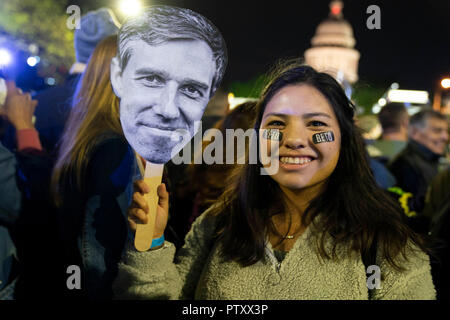 A woman in the crowd holds a Beto mask as the former congressman Beto O'Rourke of El Paso, TX kicks off his presidential campaign at a late night rally in front of the Texas Capitol. - Stock Image
