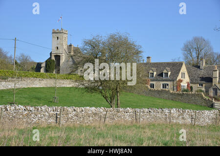 St Mary's Church in the Cotswold village of Swinbrook near Burford, Oxfordshire - Stock Image