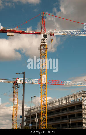 Construction cranes working in the European Union precinct of Strasbourg, Alsace, France - Stock Image