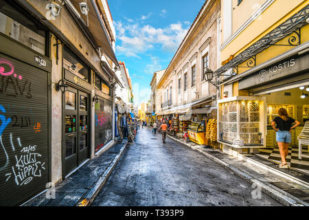 A typical touristy street and neighborhood in the Plaka District of Athens, Greece, with cafes, souvenirs and markets - Stock Image