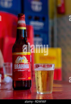 Petropolis, Rio de Janeiro, Brazil- December 21, 2018: A bottle of Brahma beer in a bar setting beside a full cup - Stock Image