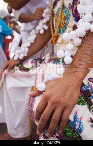 Thailand, Ko Phuket, Phuket.  The arm of a Ma-Thong (spirit medium) pierced by hundreds of metal skewers - Stock Image