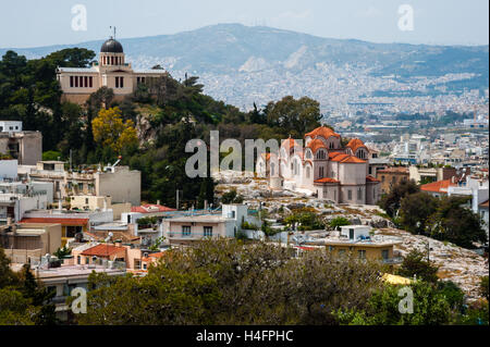 Athens, Greece. View from Areopagus below the Acropolis.  The National Observatory of Athens and Agia Marina church. - Stock Image