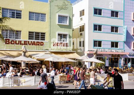 Miami Beach Florida Ocean Drive New Year's Day Art Deco District Boulevard Hotel sidewalk cafe restaurant umbrellas alfresco a - Stock Image