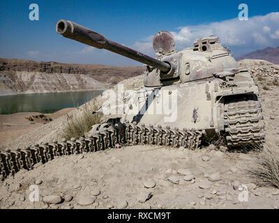 Destroyed Soviet tank on the Jalalabad Road, Afghanistan - Stock Image