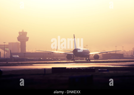 Commercial airliner taxiing at London Gatwick Airport, UK - Stock Image