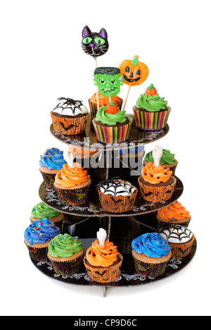 Three tier cupcake stand with lollipops on the top - Stock Image