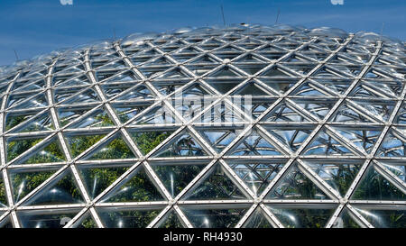 Exterior of the Bloedel Conservatory: The bulging triangular panels of the dome that encloses the conservatory in the heart of Queen Elizabeth Park. - Stock Image
