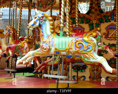 Colourful merry-go-round horse on a carousel - Stock Image