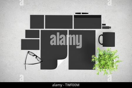 top view of dark branding elements on concrete desktop mockup 3d rendering - Stock Image