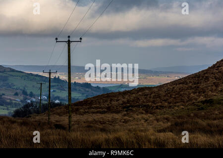 Ardara, County Donegal, Ireland. 26th December 2018. Looking down into the village from surrounding hills on a generally overcast day with some sunshine. Credit: Richard Wayman/Alamy Live News - Stock Image