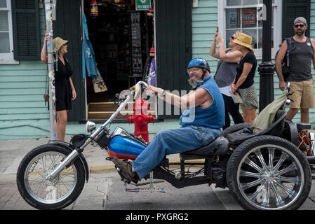 middle-aged man on a very big and fancy motorcycle in Key West Florida - Stock Image