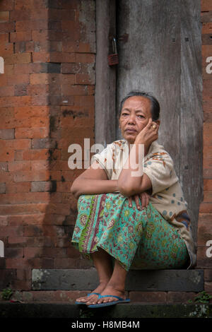 A Woman just watching around the village in her lazy time in Tenganan Village, Bali - Stock Image