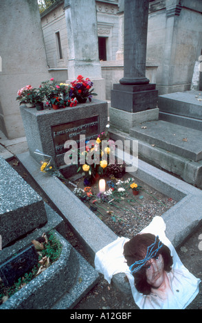 Paris France, 'Jim Morrison' Grave 'Pere Lachaise Cemetery' with decorations left by Fans, Graveyard flowers - Stock Image