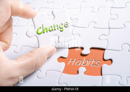 The Words Change And Habits In Missing Piece Jigsaw Puzzle - Stock Image