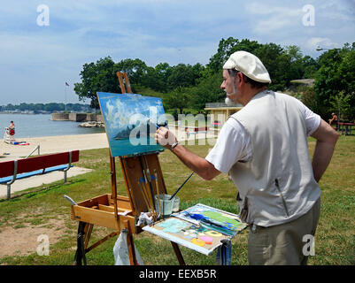 Frank A. Pollifrone Sr., paints a landscape near the beach at Branford Point on Tuesday morning. Pollifrone, a professional - Stock Image