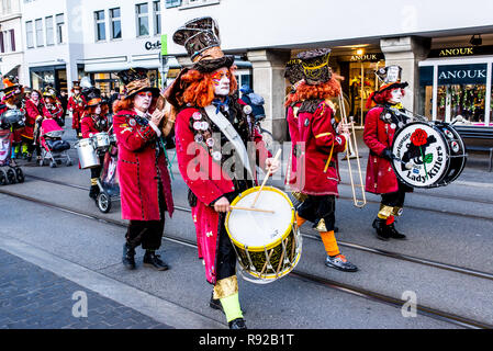 Zurich, Switzerland - March 2017: People marching and playing instruments in Zurich carnival parade - Stock Image