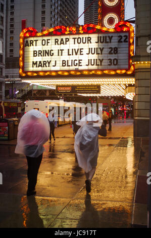 Chicago, United States. 14th Jun,  2017. Some make do Ponchos have been worn to negate the effects of the storm - Stock Image