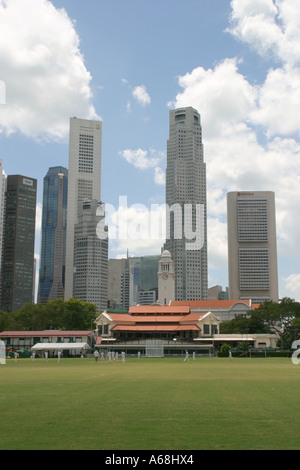 The cricket pitch, Pavilion, and business district, Padang, Singapore - Stock Image