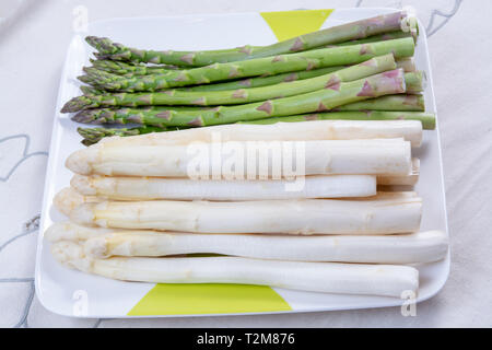 New harvest of white and green asparagus vegetable in spring season, washed asparagus ready to cook, spring menu for restaurants close up - Stock Image