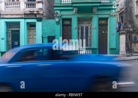 Old blue American car speeding along in Havana Cuba - Stock Image
