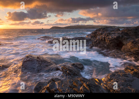 Waves crash against the rocky shores of Constantine Bay, looking towards Trevose Head, Cornwall. Summer (July) 2017. - Stock Image