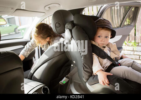 Baby boy son (18-23 months) sitting in car - Stock Image