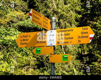 Signpost on a Swiss footpath in the French-speaking part of Switzerland - Stock Image