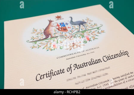 Detail of a Certificate of Australian Citizenship with pixelated private information. - Stock Image