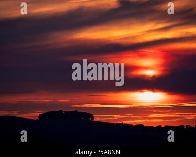 Ashbourne, Derbyshire, UK. 26th June, 2018. UK Weather: spectacular sunset over the ancient woods Hazleton Clump Cairn near Thorpe taken from Ashbourne Derbyshire, Peak District National Park Credit: Doug Blane/Alamy Live News - Stock Image