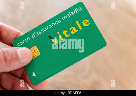 Paris,  France - November 15, 2018 : Vital card in the hand of an insured - Stock Image