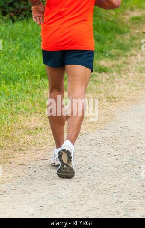 Muscled legs runner - Stock Image