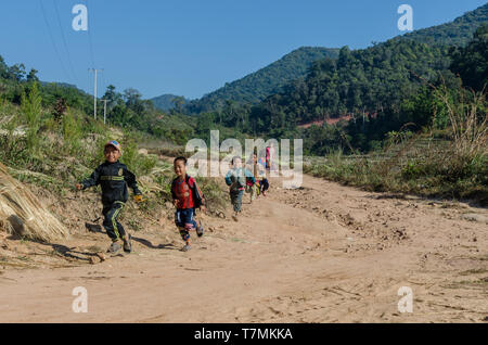 Children play in their village in the countryside of Phongsali, Laos - Stock Image