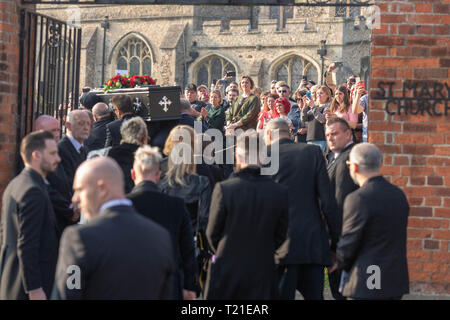 Braintree, Essex, UK. 29th Mar 2019.  Funeral of Prodigy frontman Keith Flint at St Mary's Church in Bocking attended by hundreds of his fans Mauners follow the coffin Credit: Ian Davidson/Alamy Live News - Stock Image