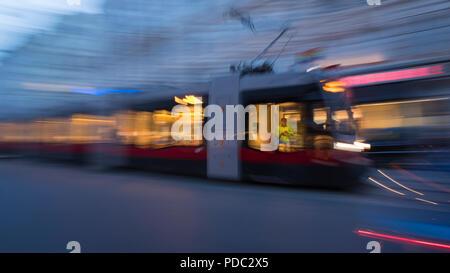 Slow shutter-speed, impression, tram, train, street car, red, Vienna, Austria, Europe - Stock Image