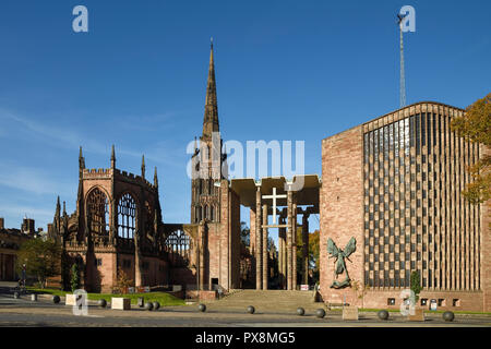 The old ruins and new Coventry Cathedral viewed from University Square on Priory Street in Coventry city centre UK - Stock Image