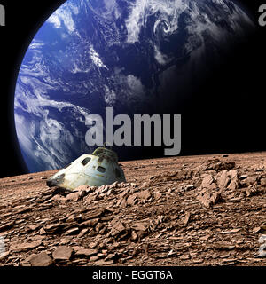 A scorched space capsule lies abandoned on a barren moon. An Earth-like planet covered in water rises in the background. - Stock Image