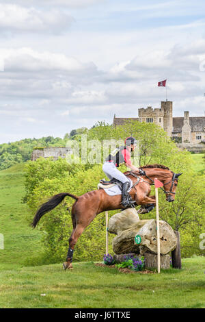 Rockingham Castle, Corby, UK. 21st May, 2017. The chinese rider Alex Hua Tian and his horse Don Geniro clear a log - Stock Image