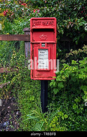 Royal Mail postbox in Kingussie, Badenoch and Strathspey, Scotland, UK. - Stock Image