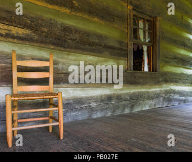 DOVER, TN, USA-30 JUNE 18: Part of the front porch of the main cabin at The Homeplace, an 1850s working farm and living history museum. - Stock Image