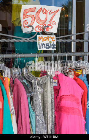Melbourne Florida Historic Downtown Main Street store retail business women's clothes apparel clothing sale rack sign half price - Stock Image