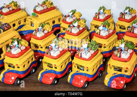 Cartagena Colombia Old Walled City Center centre San Diego shopping display sale souvenirs ceramic figurines chiva artisan rustic bus - Stock Image