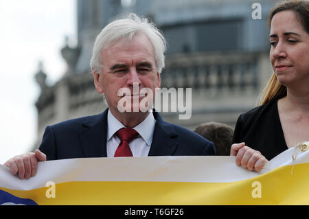 London, UK. 1st May, 2019. Helen Flanagan PCS union and  John Martin McDonnell British Labour Party politician the Shadow Chancellor of the Exchequer the Member of Parliament for Hayes and Harlington. Mayday rally in Trafalgar Square. Credit: JOHNNY ARMSTEAD/Alamy Live News - Stock Image