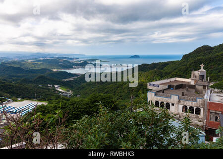 Magnificent views of the Chinese church and Pacific Ocean from the Jiufen village on November 7, 2018, in Jiufen, Taiwan - Stock Image