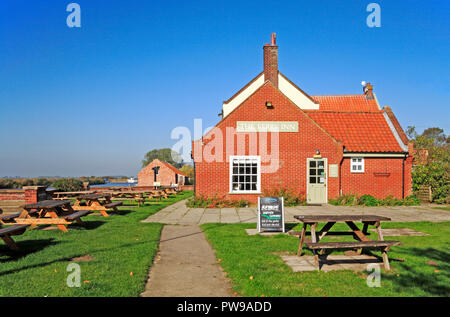 A view of The Ferry Inn by the River Bure on the Norfolk Broads at Stokesby, Norfolk, England, United Kingdom, Europe. - Stock Image