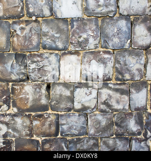 Detail of a wall built of flint as a background - Stock Image