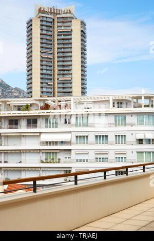 MONTE CARLO, MONACO - AUGUST 20, 2016: Monte Carlo terrace with white building and skyscraper view in a summer day in Monaco - Stock Image