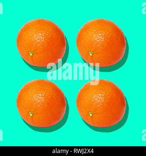 Oranges pattern on pastel background. - Stock Image